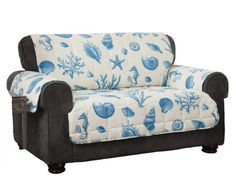 Protect your furniture in true coastal style with the Shells Sofa Protector. This quilted polyester design features a charming array of shells, coral and starfish in shades of blue against a cream ground and is water and stain resistant. Sofa Protector, House Inside, Couch Covers, Furniture Covers, Pet Furniture, Decorating On A Budget, Coastal Decor, Coastal Style, Coastal Living