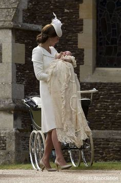 The Christening of Princess Charlotte Elizabeth Diana 2015.  Princess Charlotte being carried by her mum, the Duchess of Cambridge.