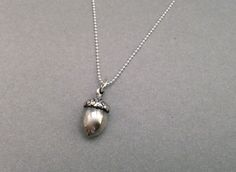 Silver Necklace with Acorn Pendant. My grandma carried a real acorn with her every single day for good luck. I would love to have a piece of acorn jewelry to carry her with me.