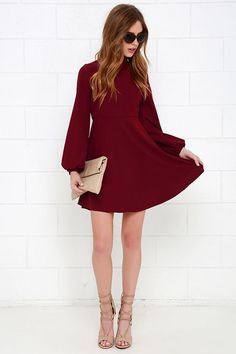 Retro is in, and our Got the Notion Wine Red Long Sleeve Dress is making waves! A stylish mock neck (with two back button closures) is formed from medium-weight woven poly fabric between billowy long sleeves with fitted button cuffs. Darting on the bodice complements the fitted waist and flaring skirt. Keyhole and hidden back zipper.