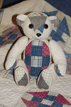 antique bear with quilt