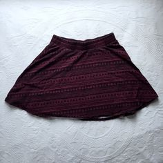 Maroon Skirt Maroon and black skirt with stripes and triangles. Worn a couple times. LA Hearts Skirts Mini