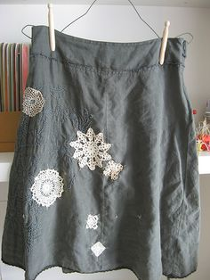 Dottie Angel covers up bleach spots with doilies! You can never have too many doilies.