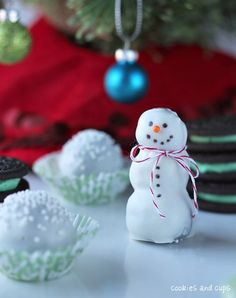 Oreo truffles and snowmen! 1 package of Mint Oreos, finely crushed, cream and all  1 8oz block of cream cheese, room temp  1 lb. of vanilla almond bark, or white candy melting disks  1 Tbsp vegetable shortening