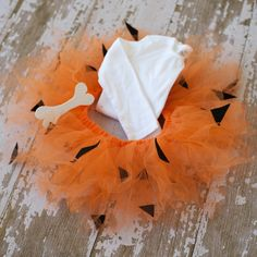 Pebbles Flintstone Tutu Halloween Costume (tutu and bone clip) NWB-5T. $38.00, via Etsy.