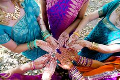 A beautiful mix of colors! Bridesmaids wore blue, purple, and pink saris for this gorgeous fall wedding. | Indian Fusion Wedding Bridesmaids Mehndi | @hilarycam Photography