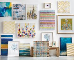 Canvas art rocks on this gallery wall.