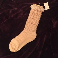 NWT Lace Ruffle Boot Socks These pretty socks are covered in a subtle heart pattern and have a lace ruffle at the top that looks so cute peeking over the tops of your boots! Brand new with tags. Accessories Hosiery & Socks