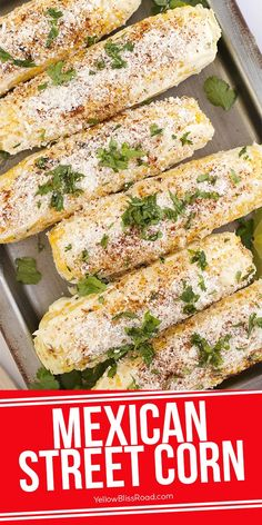 Mexican Corn (Elote) is the most delicious way to eat corn on the cob - grilled and topped with mayo chili powder, cheese, cilantro and lime. This is a great Summer side dish that everyone will love! #streetcorn #grilledcorn #cornonthecob