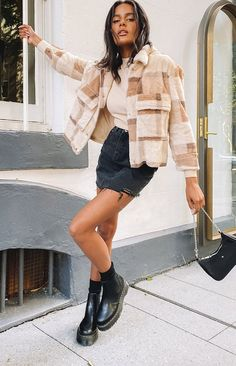 Faux fur jacket  Wear it over all your winter faves  Soft fluffy fabric  Brown and tan check  5x buttons down the front  2 breast pockets   Collared  Lined