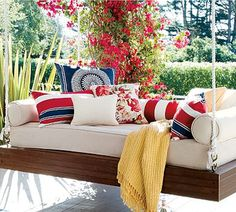 Why have a swing when you can have a hanging bed on the porch?