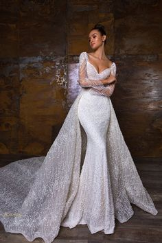 A sophisticated long sleeve column dress with re… Crystal Design: PENELOPE dress. A sophisticated long sleeve column dress with removable overskirt. Stunning Wedding Dresses, Dream Wedding Dresses, Bridal Dresses, Lace Wedding, Gorgeous Dress, Luxury Wedding Dress, Backless Wedding, Dresses Dresses, Bridal Lace