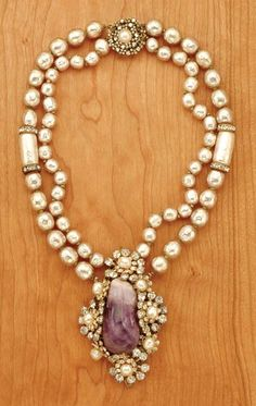 Miriam Haskell Quartz Pendant Necklace:  American, 1950s  -  Double strand of faux baroque pearls with diamond-shaped pendant centered by an irregular amethyst colored quartz stone, rhinestone and pearl floral frame, 13 x 1 inch, pendant 3 x 2 inches, marked: Miriam Haskell.