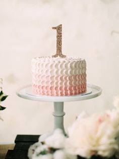 feminine pink first birthday cake
