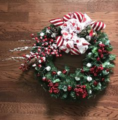 Beautiful Christmas and Winter Wreath. Handcrafted with cardinal ribbon, jingling ornaments, and winter berries.