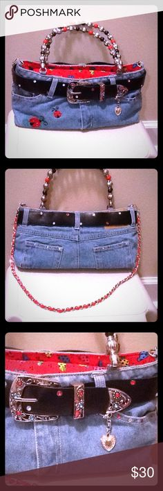 Blue Jeans Style Handbag Handmade Super cute handbag, handmade, NWOT, smaller to medium style, lady bug patterns on outside and inside, black belt has beautiful rhinestones, red, blue and white, handles have red, black and silver beads, removable shoulder strap has a red ribbon style strap inside a silver chain.  Approx measurements: 13 in long, 6.5 in tall, 5 in wide, 6 in handles, 15 in removable strap.  Any lady will enjoy this but a younger girl or teenage girl should really enjoy…