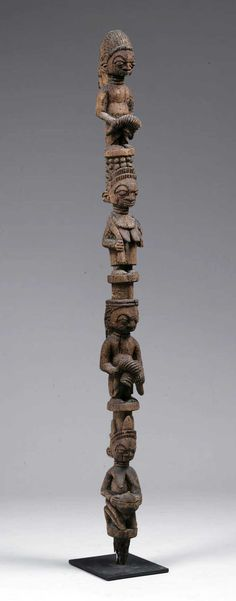 Africa | Staff from the Yoruba people; probably for Eshu.  Carving style places it in the Ekiti region, although one might assume at first glance it was carved by Bamgboye of Osi Illurin.  |  Wood; remains of encrusted materials over extremely aged surface.