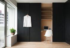 matte black wardrobe doors. hidden desk nook behind doors. #homeoffice