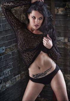 female stomach tattoo