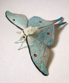 Indian Luna Moth textile art by Yumi Okita. Materials: fabric, cotton, fake fur, fabric paint, embroidery thead, wire, feather.
