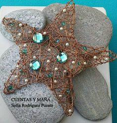 Estrella de aluminio,  cristal y perlas ... Cuentas y maña