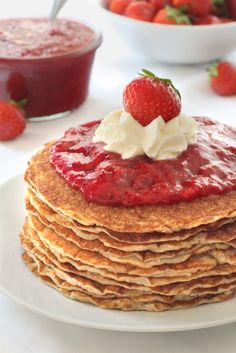 These gluten-free pancakes are almost crepe-like and are served with homemade strawberry sauce!
