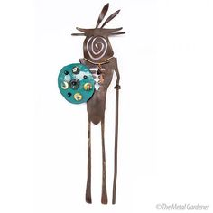 """Do you have a space on your wall that needs a pop of Southwest design? This rustic wall art is called """"The Elder."""" It is rusted steel that has been sealed and the teal is a handmade copper shield with aqua enamel, turquoise and amber accents. Hand crafted in Tucson, Arizona.#homedecor #southwestdecor #walldecor Aqua, Teal, Turquoise, Southwest Decor, Rustic Wall Art, Handmade Copper, Wall Decor, Sculpture, Crafts"""