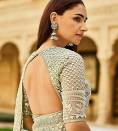 Latest bridal blouse designs - Tikli The much awaited list is here Ladies. Have a look at the latest blouse designs trends for this year. The list will surely amaze you. Read on. Blouse Back Neck Designs, Sari Blouse Designs, Designer Blouse Patterns, Fancy Blouse Designs, Bridal Blouse Designs, Blouse Styles, Designer Saree Blouses, Latest Blouse Designs, Lehenga Designs Latest