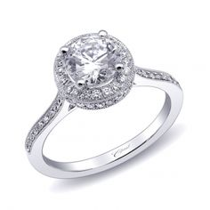 A unique engagement ring featuring pave set diamonds on the top and side of the halo, as well as the shoulders of the ring. (LC10064) #engagement #wedding #proposal