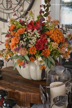 A Blooming Pumpkin Centerpiece for a fall table | homeiswheretheboatis.net #tablescape #DIY