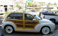 Just a car guy : 2 of 10 woody custom PT Cruisers made in Riverside. One got the great looks and headlights, the other got the hood ornament...