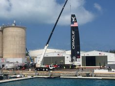 Team USA's entry in the Americas Cup gets lowered into the bay for its daily practice runs