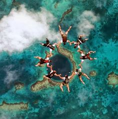 The Big Blue hole in Belize. I think I can swim with whale sharks in Belize too. Still not sure on skydiving?