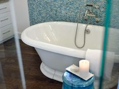 Browse through luxurious master bathroom photos from HGTV Smart Home and vote for the space you love the most.