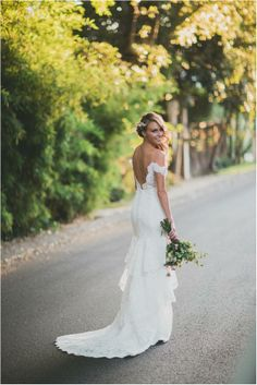 """On August 17, 2013 Keltie Collen, correspondent for the entertainment news television show OMG!Insider said """"I Do"""" in Watters Elsa gown during her Californian bohemian, gypsy, rock n' roll, Mexican seaside village wedding.   Keltie customized Watters Elsa gown by altering the neckline from v-neck to a elegant off the shoulder neckline."""