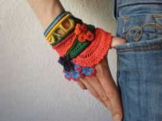 Heliamphora Folliculata ... Freeform Crochet Cuff - Flowers -  Magenta Yellow Red Blue Green - Beaded Beadwork. $168.00, via Etsy.