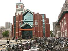 To church on a bike. Beiguan Seventh-day Adventist Church, Shenyang, China. Congregation of 3,000 meets in the biggest Seventh-day Adventist Church in China.