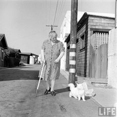 In 1947, Loran Smith photographed a blind woman and her seeing-eye cat for LIFE magazine.
