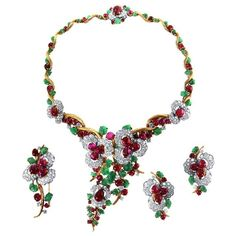 Mauboussin Cabochon Ruby, Carved Emerald, Brilliant Diamond, Platinum and 18K Gold Suite