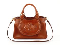 In riding a horse we borrow freedom. #leather #purses #handbags #horse #cowgirl…