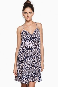 A flowy, chic sleeveless racerback dress, detailed with a tribal print.