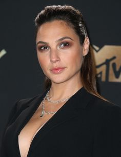 Gal Gadot finished the look with a Wonder Woman-inspired hairdo