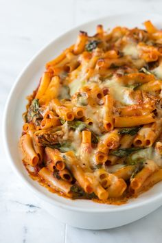Simple Baked Ziti Recipe with Spinach, Artichokes and Pesto ( http://www.inspiredtaste.net/17151/easy-baked-ziti-recipe-with-spinach-artichokes-and-pesto/ )