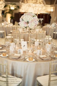 Blush pink wedding centerpiece by www.theflowerhouse.com