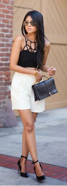 Gorgeous white casual skirt with top black stripes blouse and cute black leather hand bag and shining black high heels ladies pumps the best way to show fashion & style