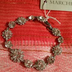 """Stunning  new Marchesa bracelet Sparkling crystals ring around the beautifully faceted stones that stud a floral-inspired bracelet with romantic style.  7"""" length; 1/2"""" width.Fold-over clasp. or silvertone plate/glass.By Marchesa; imported. Marchesa Jewelry Bracelets"""