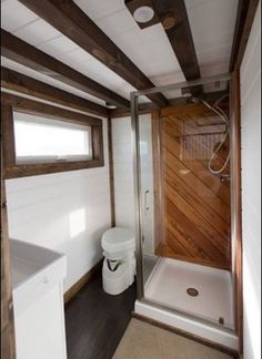 """The Lookout was built by Tiny House Chattanooga. It's based off their award-winning Lookout that won """"Best in Show"""" at the 2016 Tiny House Jamboree. Tiny House Company, Tiny House Swoon, Tiny House Builders, Tiny House Listings, Modern Tiny House, Tiny House Plans, Tiny House Design, Cabin Bathrooms, Tiny Bathrooms"""