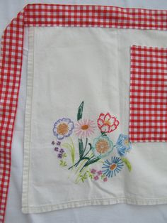 Apron made from recycled embroidered linen tablecloth & gingham. £15.00, via Etsy.