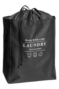 Small laundry bag in cotton twill with printed text, two handles, and plastic coating inside. Top section in lighter-weight fabric with a drawstring Laundry Logo, Laundry Shop, Coin Laundry, Laundry Design, Small Laundry, Laundry Basket, Laundromat Business, Laundry Business, Dry Cleaning Business