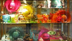 "Premier Optical summer Window Displays Summer Window Display 2008 This display for Summer 2008 ""Life's a Beach"" featured groupings of color coordinated beach attire and accessories such as straw hats, flip flops, water bottles, fans, pails and shovels, beach bags and beach balls."